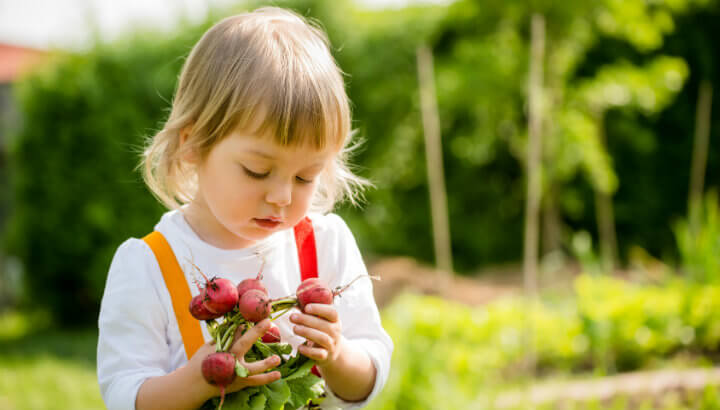 Get kids outside to plant flowers (or veggies!) in the garden.